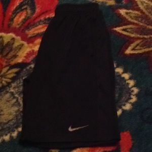 Boy's Nike black shorts with gray swoosh